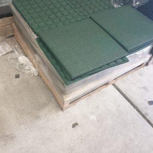 Groene rubber terrastegels